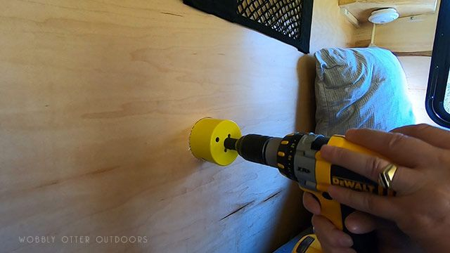 hole saw drilling begins inside the camper cabin