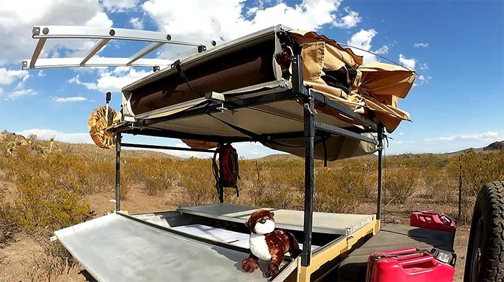 rooftop tent folded up by wind